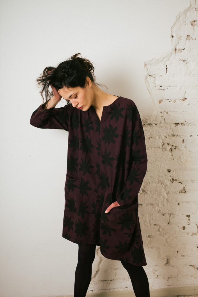 Loose pop-over twill tunic in aubergine with black flower print.