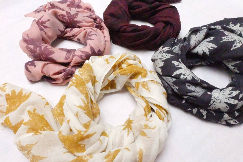 Block printed flower scarves in wool gauze fabric.
