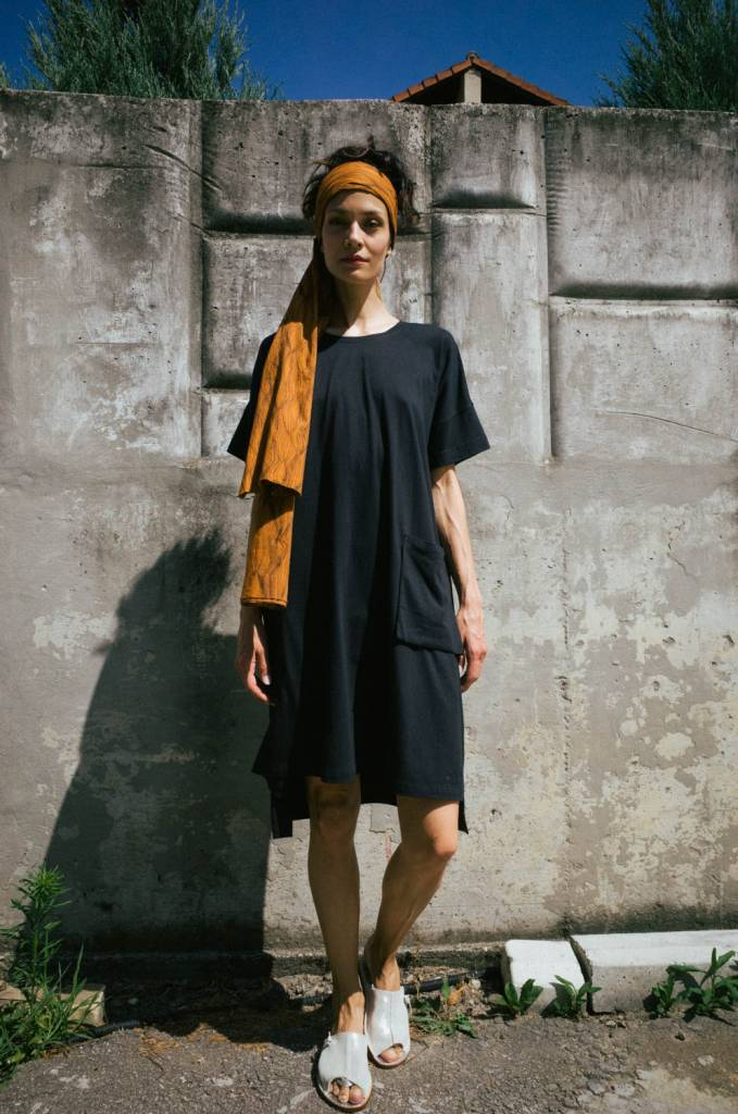 The Square Tee Dress features a high neckline and an elbow length wide sleeve. The dress sits above the knee at the front and is stepped lower at the back.