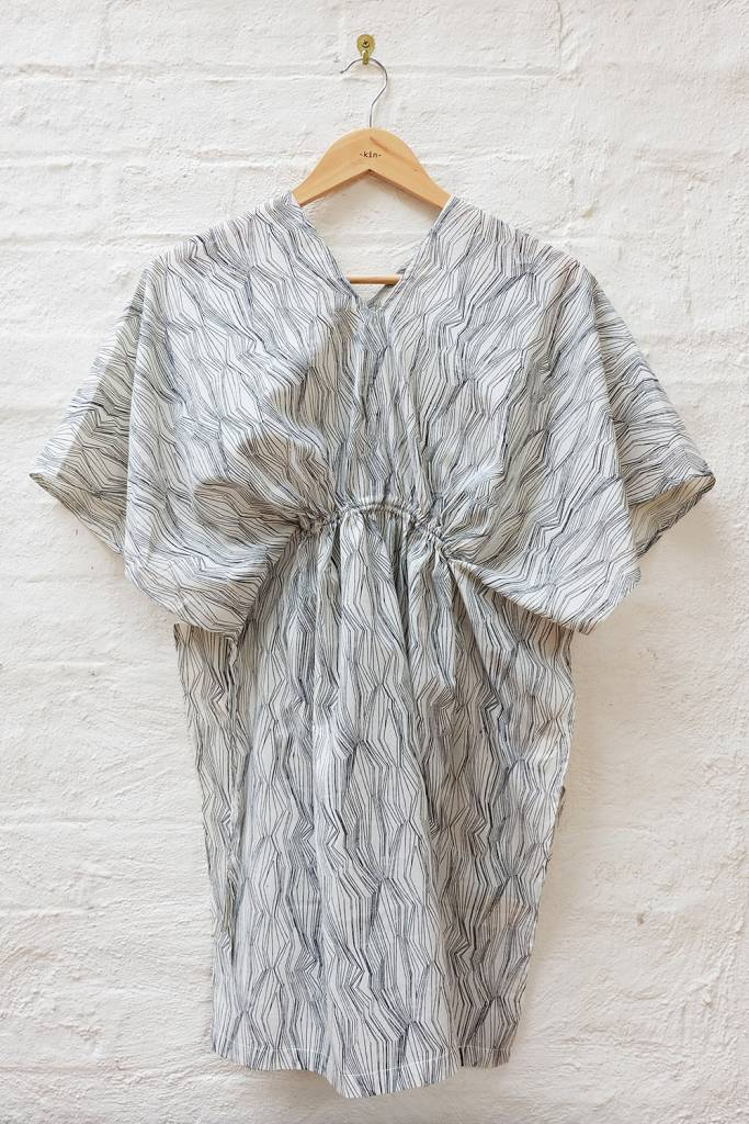Unstructured dress with gathered drawstring at front and back