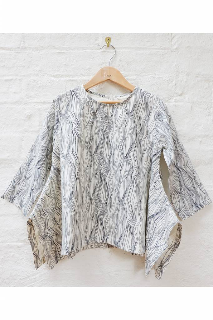 Fine line printed flared pull over top in woven fabric