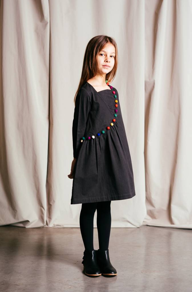 Organic cotton sateen dress features a colourful pom-pom trim accent.