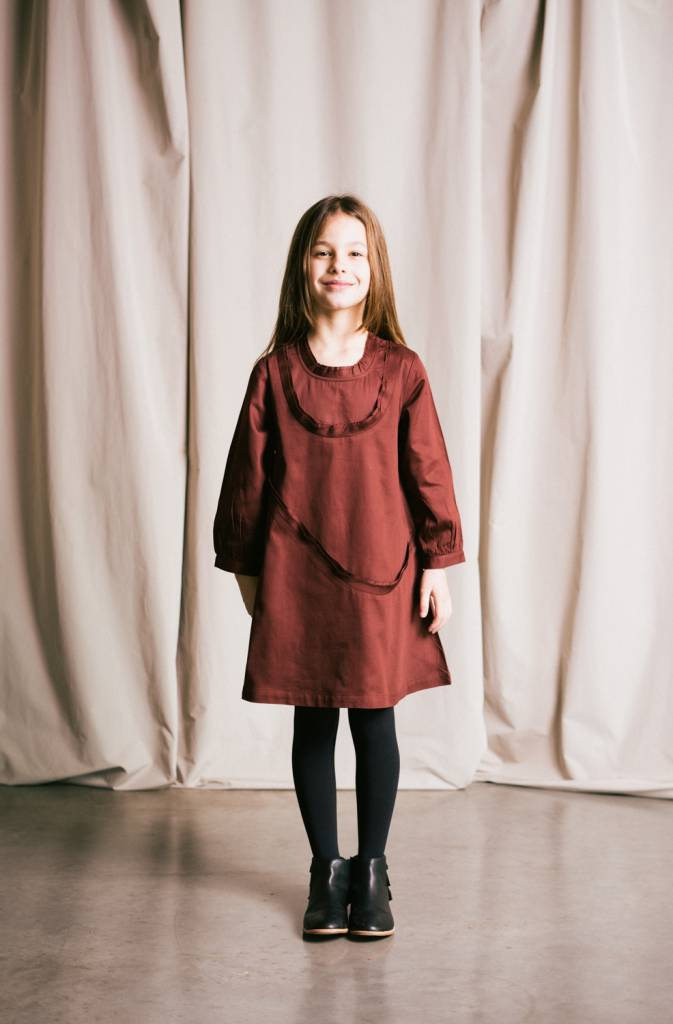 Flared dress in organic cotton sateen that features raw bias ruffles wrapping around neck .