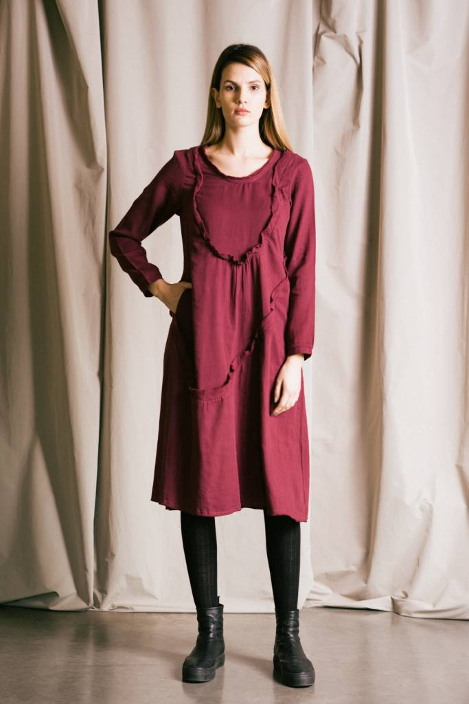 Women's flared dress with diagonal ruffles.