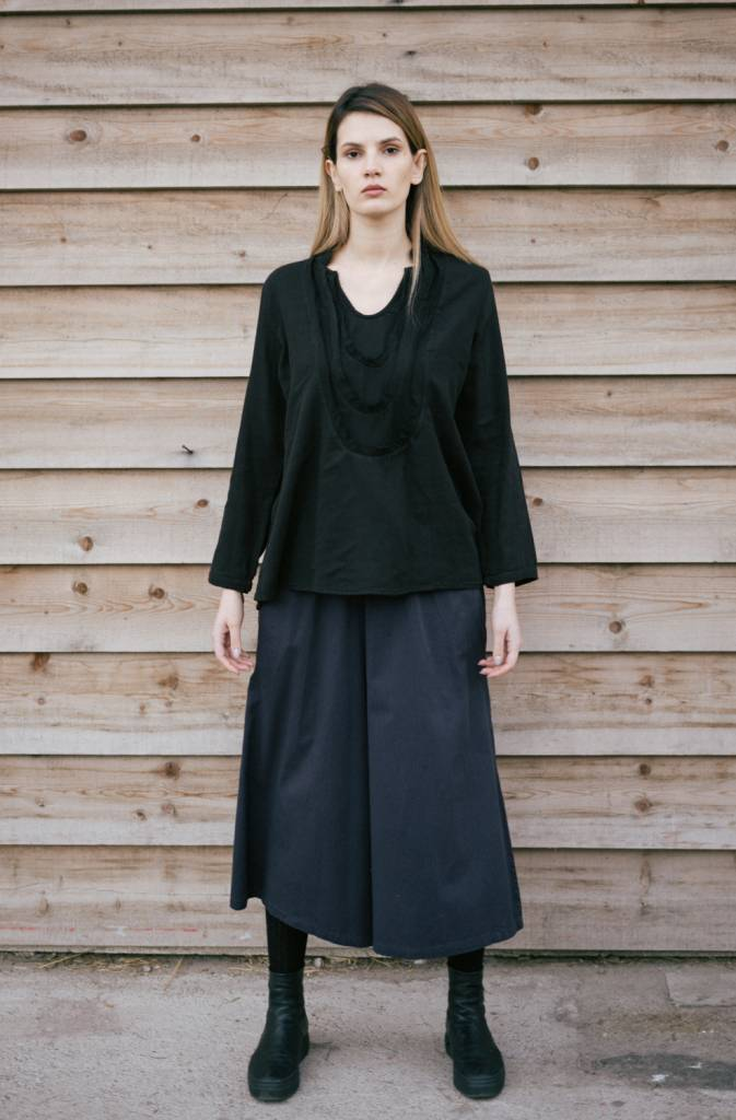 Flared shirt featuring layers of raw bias ruffles around neck.