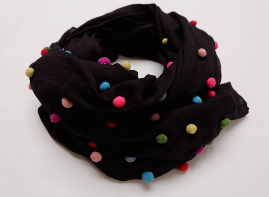 Organic Cotton shawl featuring multicoloured scattered pom-pom accents.